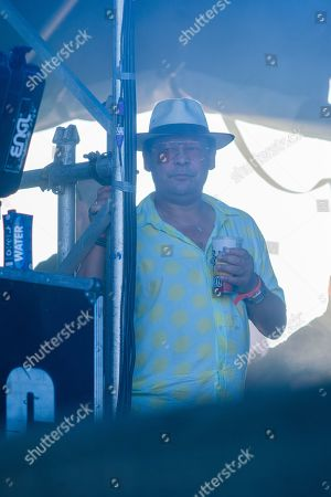 Craig Charles watches Fun Lovin' Criminals on stage.