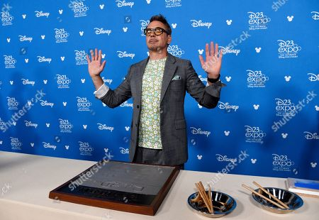 Robert Downey Jr. takes part in his handprint ceremony at the Disney Legends press line during the 2019 D23 Expo, in Anaheim, Calif