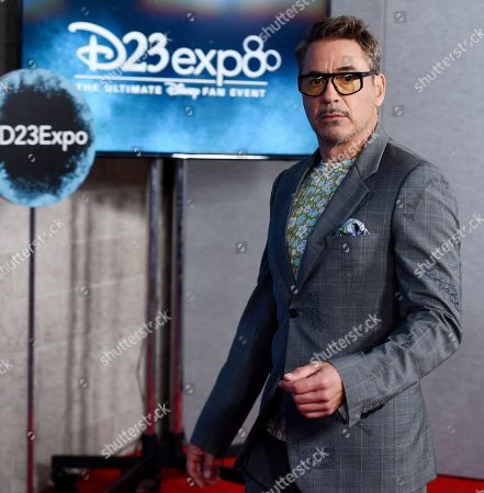 Robert Downey Jr. arrives at the Disney Legends press line during the 2019 D23 Expo, in Anaheim, Calif