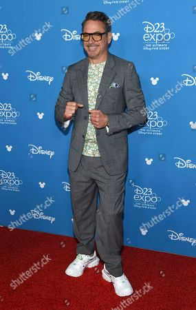 Robert Downey Jr. poses at the Disney Legends press line during the 2019 D23 Expo, in Anaheim, Calif