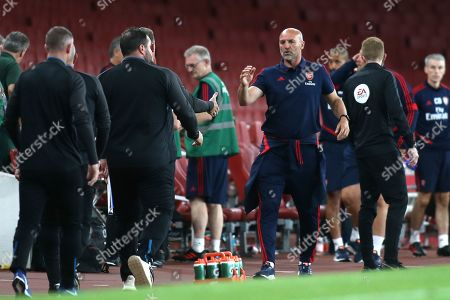 Arsenal U23 Manager, Steve Bould, walks towards the Everton coaching staff at the final whistle to shake their hands during Arsenal Under-23 vs Everton Under-23, Premier League 2 Football at the Emirates Stadium on 23rd August 2019