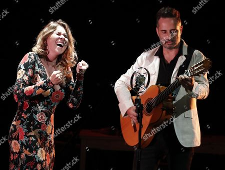 Stock Picture of Spanish flamenco singer Rocio Marquez (L) and Spanish-Uruguayan singer and composer Jorge Drexler (R) perform on stage during their concert on occasion of the VI Flamenco on Fire Festival in Pamplona, Navarra, northern Spain, 23 August 2019.