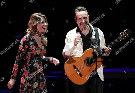 Stock Photo of Spanish flamenco singer Rocio Marquez (L) and Spanish-Uruguayan singer and composer Jorge Drexler (R) perform on stage during their concert on occasion of the VI Flamenco on Fire Festival in Pamplona, Navarra, northern Spain, 23 August 2019.