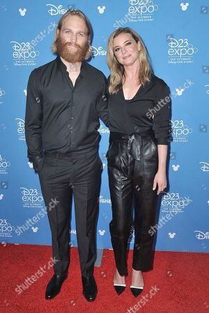 Stock Image of Wyatt Russell, Emily VanCamp attends the Disney+ press line at the 2019 D23 Expo, in Los Angeles