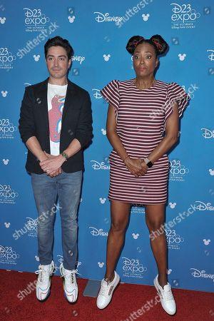 Ben Feldman, Aisha Tyler. Ben Feldman, left, and Aisha Tyler attend the Disney+ press line at the 2019 D23 Expo, in Anaheim, Calif