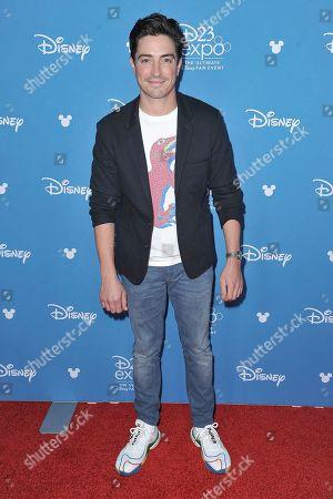 Ben Feldman attends the Disney+ press line at the 2019 D23 Expo, in Anaheim, Calif