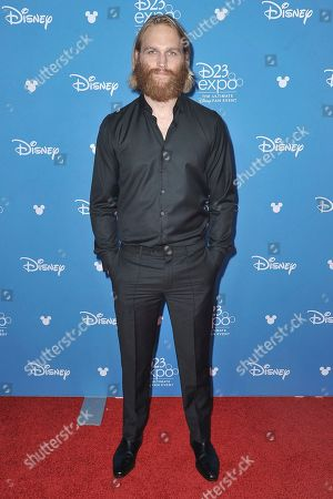 Wyatt Russell attends the Disney+ press line at the 2019 D23 Expo, in Los Angeles