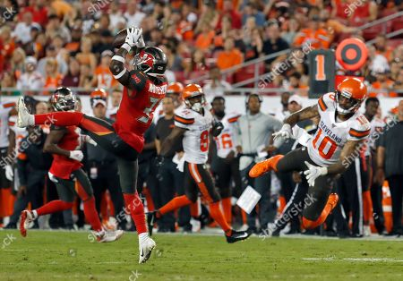Tampa Bay Buccaneers free safety Jordan Whitehead (31) intercepts a pass intended for Cleveland Browns wide receiver Jaelen Strong (10) during the first half of an NFL preseason football game, in Tampa, Fla