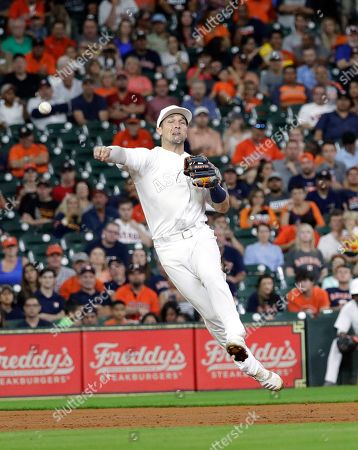 Stock Image of Houston Astros shortstop Alex Bregman throws to first after fielding a single by Los Angeles Angels' David Fletcher during the third inning of a baseball game, in Houston
