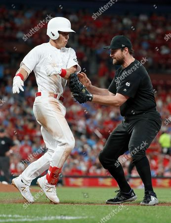 Colorado Rockies first baseman Daniel Murphy, right, tags out St. Louis Cardinals' Tommy Edman to end the sixth inning of a baseball game, in St. Louis