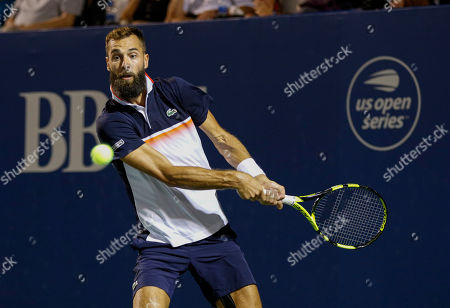 Benoit Paire, of France, hits a return to Steve Johnson, of the United States, during the Winston-Salem Open tennis tournament in Winston-Salem, N.C