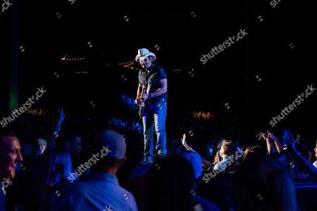 Brad Paisley performs on stage at Ameris Bank Amphitheatre, in Alpharetta, Ga