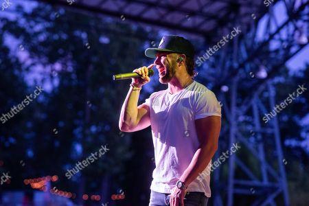 Chris Lane performs on stage at Ameris Bank Amphitheatre, in Alpharetta, Ga