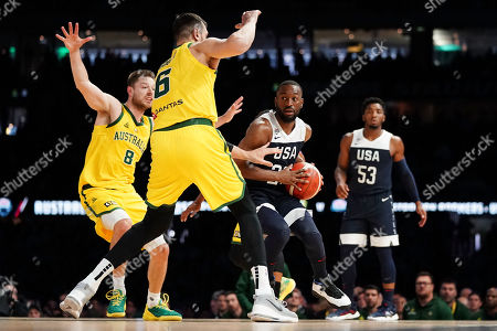 Kemba Walker of the USA and Andrew Bogut of Australia compete for the ball during match two of the Pre-FIBA World Cup series between Australia and the USA at Marvel Stadium in Melbourne, Australia, 24 August 2019.