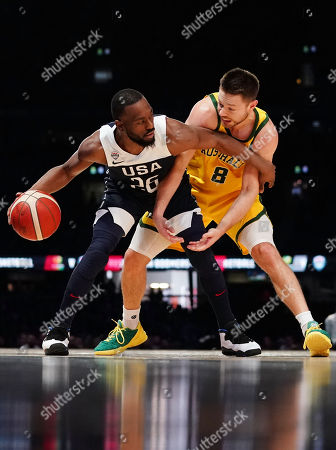 Kemba Walker (L) of the USA and Matthew Dellavedova (R) of Australia compete for the ball during match two of the Pre-FIBA World Cup series between Australia and the USA at Marvel Stadium in Melbourne, Australia, 24 August 2019.