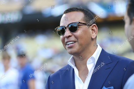 Former Yankee Alex Rodriguez chats with friends before the game between the New York Yankees and the Los Angeles Dodgers at Dodger Stadium in Los Angeles, CA. (Photo by Peter Joneleit)