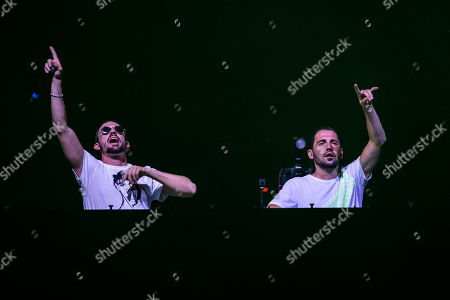 Stock Photo of Belgian DJ brothers Like Mike (Michael Thivaios) and Dimitri Vegas (Dimitri Thivaios) perform at Strand Festival in Zamardi at Lake Balaton, Hungary, 23 August 2019 (issued 24 August). The festival runs from 20 to 24 August.