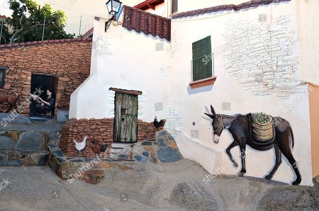 Stock Photo of A general view of a mural depicting daily life scenes in the village of Romangordo, in Extremadura, western Spain, 24 August 2019. The village, with a population of 300, has managed to attract some 25,000 tourists, so far this year, with its 'Route of Trompe l'oeil' made up of several realistic murals painted in walls and the facades of houses.