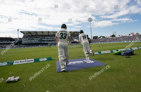 Australian batsman Australia's Marnus Labuschagne, left, and James Pattinson prepare to enter the field on day three of the third Ashes Test cricket match between England and Australia at Headingley cricket ground in Leeds, England