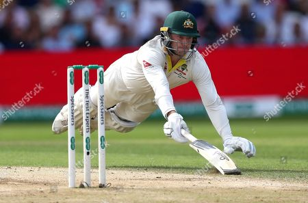 Australia's James Pattinson dives to make his ground while batting during play on day three of the third Ashes Test cricket match between England and Australia at Headingley cricket ground in Leeds, England