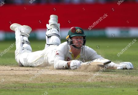 Australia's James Pattinson slides on the ground to make his ground while batting during play on day three of the third Ashes Test cricket match between England and Australia at Headingley cricket ground in Leeds, England