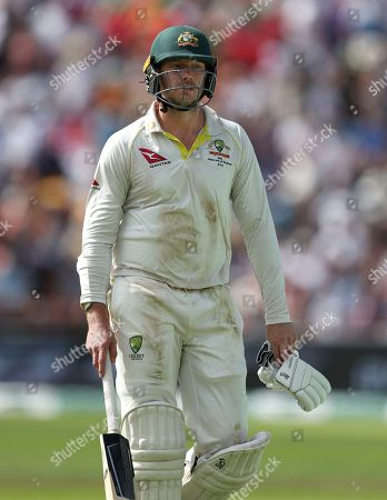 Australia's James Pattinson walks from the field after he was dismissed during play on day three of the third Ashes Test cricket match between England and Australia at Headingley cricket ground in Leeds, England