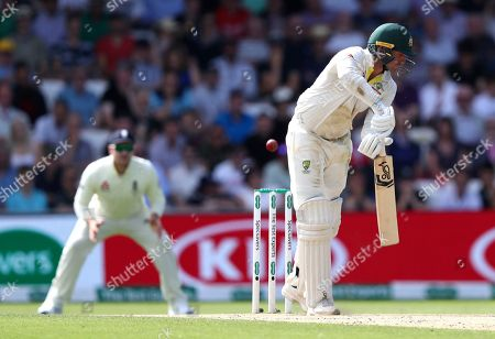 Australia's James Pattinson plays at the ball to be out caught during play on day three of the third Ashes Test cricket match between England and Australia at Headingley cricket ground in Leeds, England