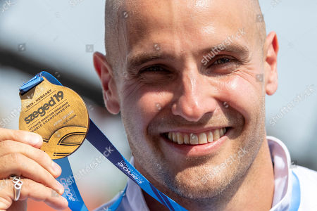 Gold medalist Liam Heath of Britain celebrates during the award ceremony for the men's K1 200m race at the ICF Canoe Sprint World Championships in Szeged, Hungary, 24 August 2019.