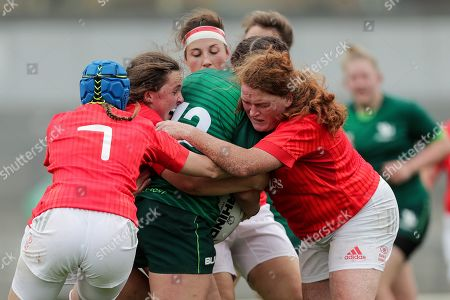 Connacht Women vs Munster Women. Connacht's Catherine Martin is tackled by Enya Breen, Fiona Reidy and Clodagh O'Halloran of Munster