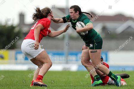 Connacht Women vs Munster Women. Connacht's Shannon Touhey with Enya Breen and Clodagh O'Halloran of Munster