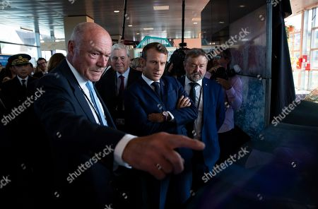 French President Emmanuel Macron (C), flanked by President of the Nouvelle-Aquitaine region Alain Rousset (L) looks at an information panel as he tours the exhibition hall above the international press center on the opening day of the G7 summit, in Anglet, France, 24 August 2019. The G7 Summit runs from 24 to 26 August in Biarritz.
