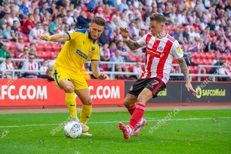 Stock Picture of Luke O'Neill (#2) of AFC Wimbledon takes on Chris Maguire (#7) of Sunderland AFC during the EFL Sky Bet League 1 match between Sunderland and AFC Wimbledon at the Stadium Of Light, Sunderland