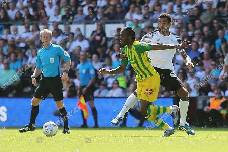 West Bromwich Albion midfielder Romaine Sawyers (19) gets away from Derby County midfielder Tom Huddlestone (44) during the EFL Sky Bet Championship match between Derby County and West Bromwich Albion at the Pride Park, Derby