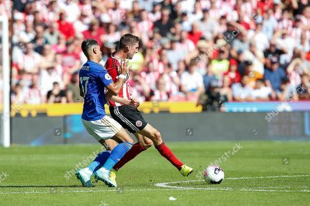 Ayoze Perez of Leicester City challenges Chris Basham of Sheffield United during the Premier League match between Sheffield United and Leicester City at Bramall Lane, Sheffield