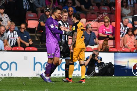 Port Vale player David Worrall (7) remonstrates Grimsby Town goalkeeper James McKeown(1) after a foul on Grimsby Town's Harry Davis(4) during the EFL Sky Bet League 2 match between Grimsby Town FC and Port Vale at Blundell Park, Grimsby