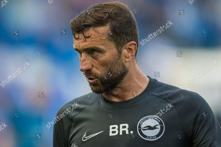 Stock Image of Ben Roberts Goalkeeping Coach warming up the goalkeepers before the Premier League match between Brighton and Hove Albion and Southampton at the American Express Community Stadium, Brighton and Hove