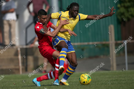 George Saunders of Hornchurch and Youssef Bamba of Kingstonian during Hornchurch vs Kingstonian, BetVictor League Premier Division Football at Hornchurch Stadium on 24th August 2019