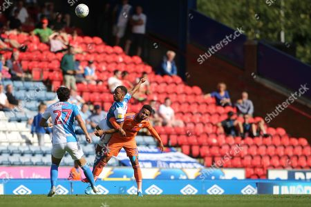 Stock Picture of Blackburn Rovers Lewis Travis looks on as Blackburn Rovers Elliott Bennett wins the header from Cardiff's Lee Tomlin  during the EFL Sky Bet Championship match between Blackburn Rovers and Cardiff City at Ewood Park, Blackburn