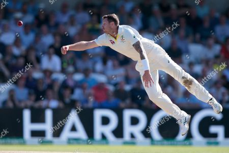Australia's James Pattinson attempts to stop a shot by England's Joe Root as he bowls on the third day of the 3rd Ashes Test cricket match between England and Australia at Headingley cricket ground in Leeds, England