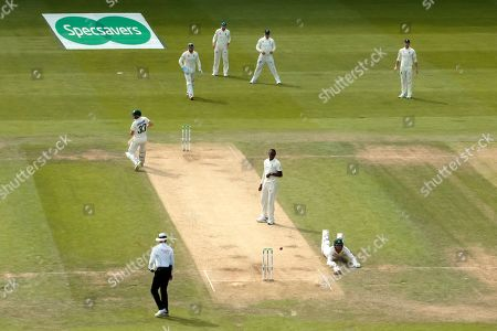 Australia's James Pattinson, bottom right, slides to make his ground while batting during play on day three of the third Ashes Test cricket match between England and Australia at Headingley cricket ground in Leeds, England