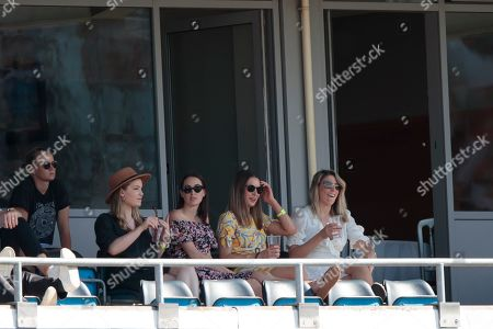 Rachel Khawaja, second left, wife of Australia's Usman Khawaja sits in the stands on the third day of the 3rd Ashes Test cricket match between England and Australia at Headingley cricket ground in Leeds, England