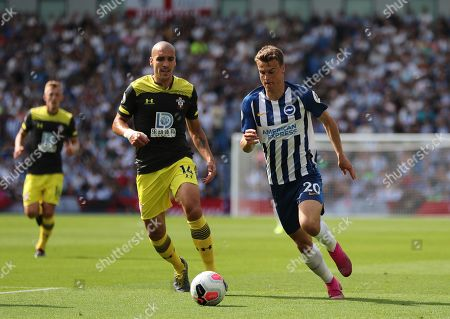 Oriol Romeu of Southampton and Solly March of Brighton.