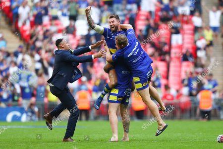 Stock Image of Warrington's Daryl Clark, Harvey Livett and Ben Westwood celebrate the win.