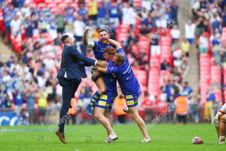 Warrington's Daryl Clark, Harvey Livett and Ben Westwood celebrate the win.