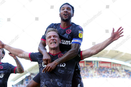 Michael Morrison (L) of Reading FC celebrates with Liam Moore (R) after scoring a goal to put Reading 2-0 up