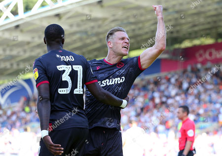 Michael Morrison (R) of Reading FC celebrates after scoring a goal to put Reading 2-0 up