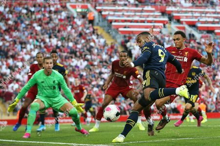 Liverpool defender Trent Alexander-Arnold (66) blocks the close range effort from Arsenal forward Alexandre Lacazette (9)  during the Premier League match between Liverpool and Arsenal at Anfield, Liverpool