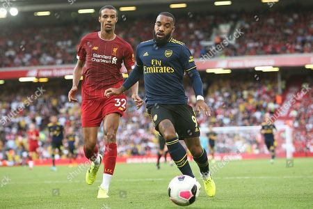 Arsenal forward Alexandre Lacazette (9) takes on Liverpool defender Joel Matip (32) during the Premier League match between Liverpool and Arsenal at Anfield, Liverpool
