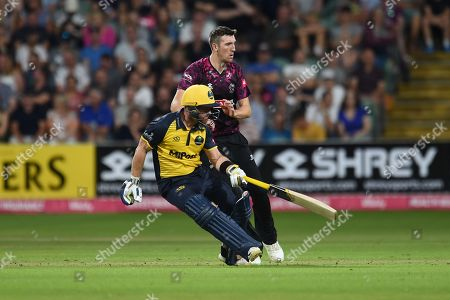 Craig Overton of Somerset and David Lloyd of Glamorgan  during the Vitality T20 Blast South Group match between Somerset County Cricket Club and Glamorgan County Cricket Club at the Cooper Associates County Ground, Taunton
