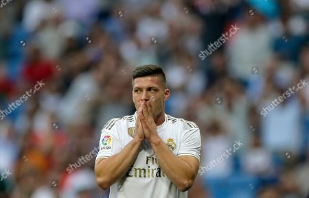 Real Madrid's Luka Jovic gestures during the Spanish La Liga soccer match between Real Madrid and Valladolid at the Santiago Bernabeu stadium in Madrid, Spain